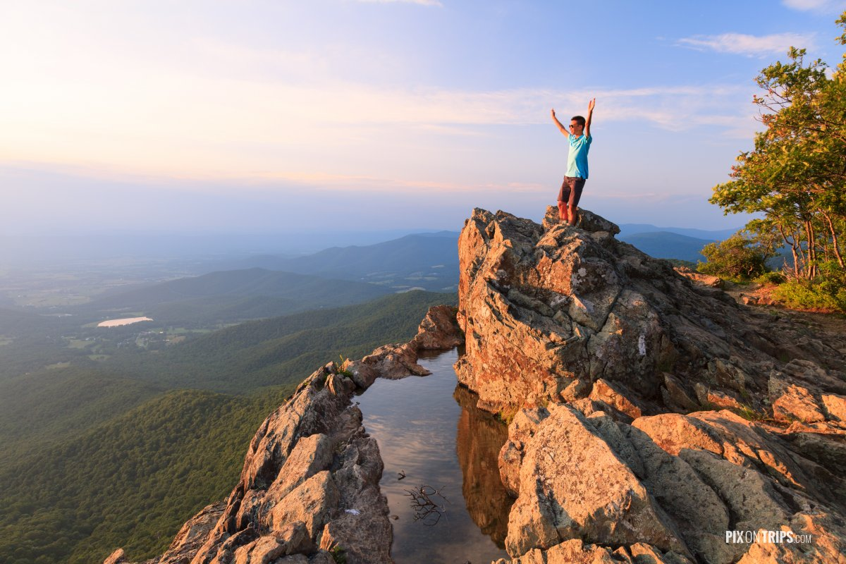 A teenager standing on the edge of a cliff - Pix on Trips