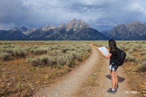 Girl reading map in Grand Teton National Park - Pix on Trips