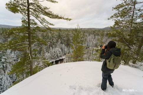 Young woman takes photo in winter - Pix on Trips