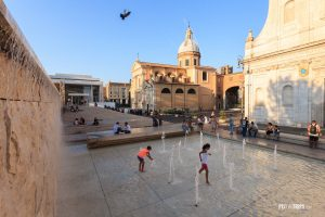 Kids play in a water fountain in Rome, Italy - Pix on Trips