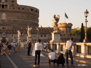 Wedding photographers take photos at the St. Angelo Bridge, Rome - Pix on Trips