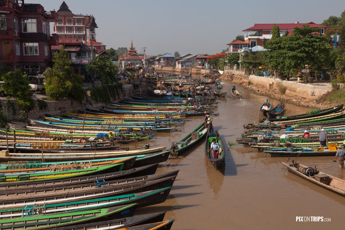 Boats waiting for tourists on canal, Nyangshwe, Myanmar - Pix on Trips