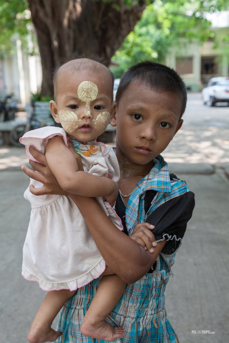 Boy holds his sister in Mandalay, Myanmar