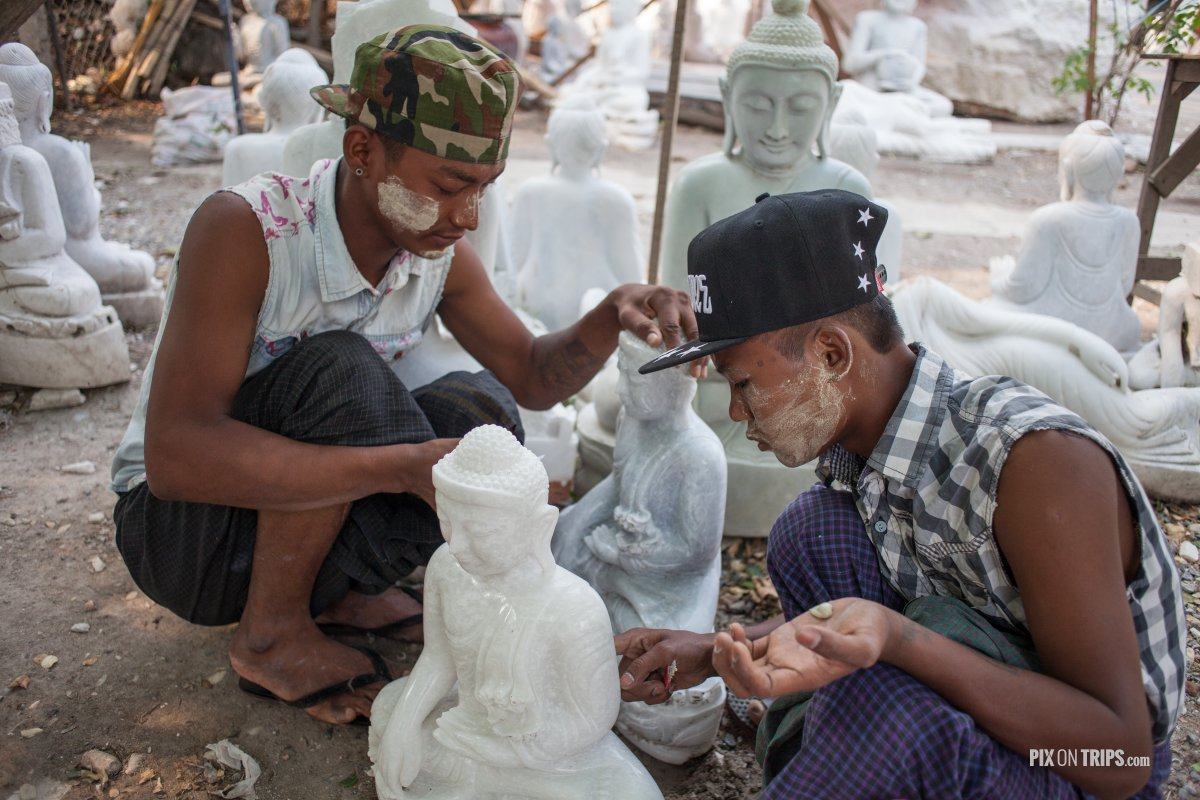 Boys carve Buddha statues in Mandalay, Myanmar