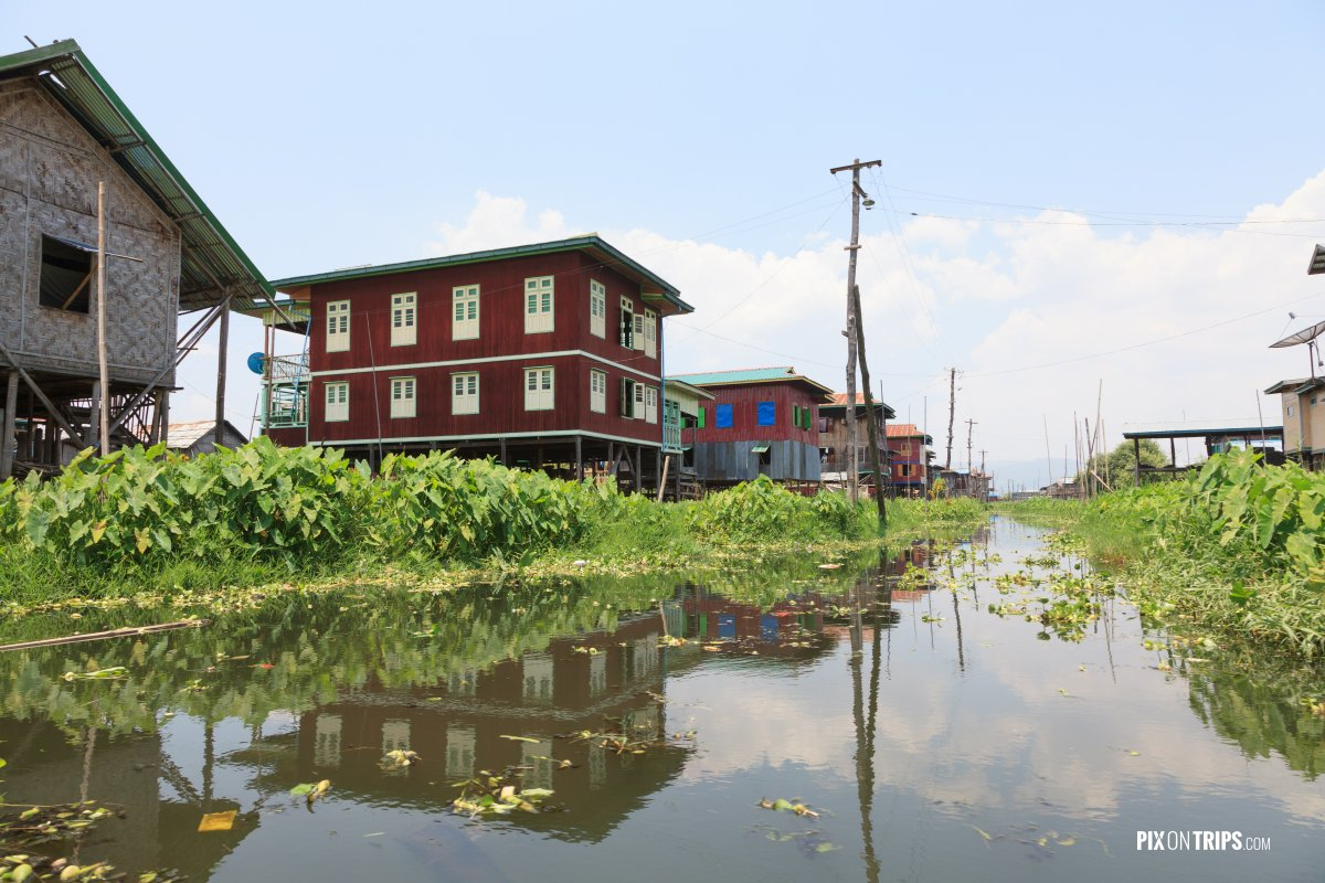 Canal lined with colourful houses on stilts, Lake Inle, Myanmar - Pix on Trips