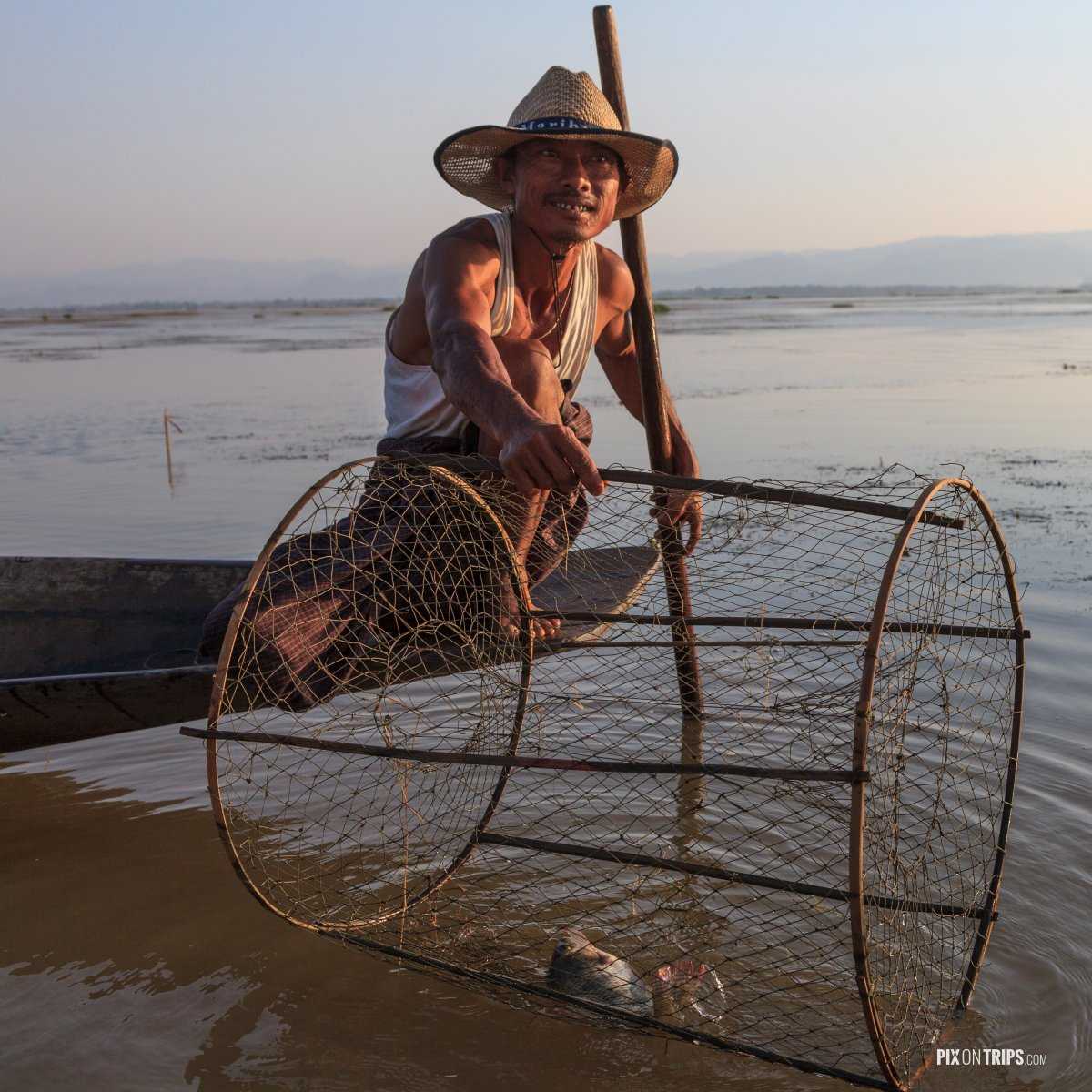 Fisherman shows catch, Lake Inle, Myanmar - Pix on Trips