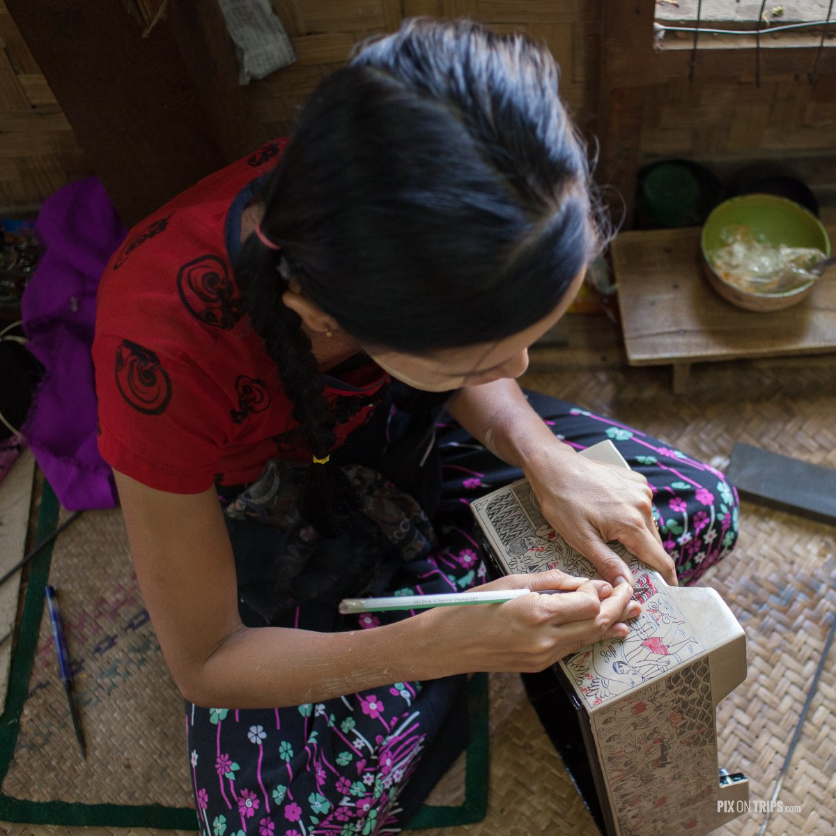 Girl decorating lacquerware in workshop, Bagan, Myanmar - Pix on Trips