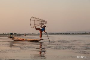 Intha fisherman posing with conical net, Lake Inle, Myanmar - Pix on Trips