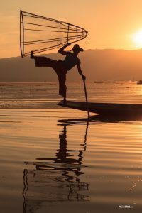 Intha fisherman posing with conical net at sunset, Lake Inle, Myanmar - Pix on Trips