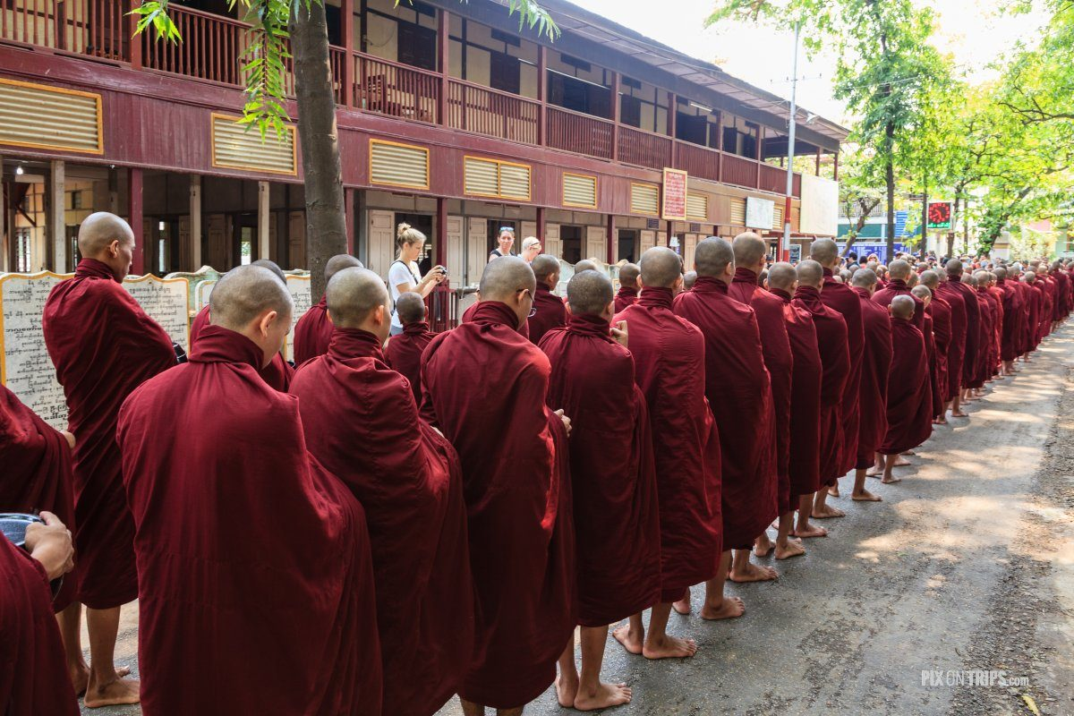 Monks line up for lunch at Mahagandayon Monastery, Mandalay, Myanmar