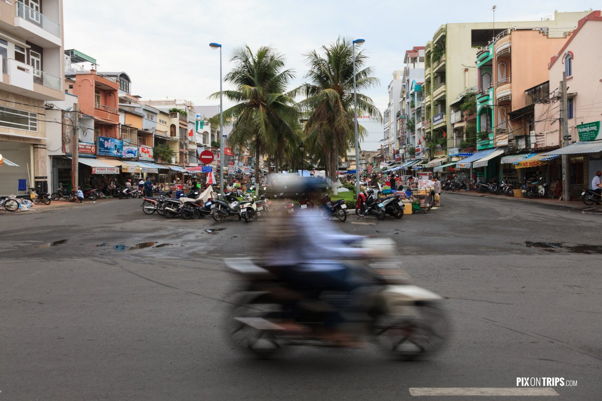 Motorbike driving by street, Can Tho, Vietnam - Pix on Trips