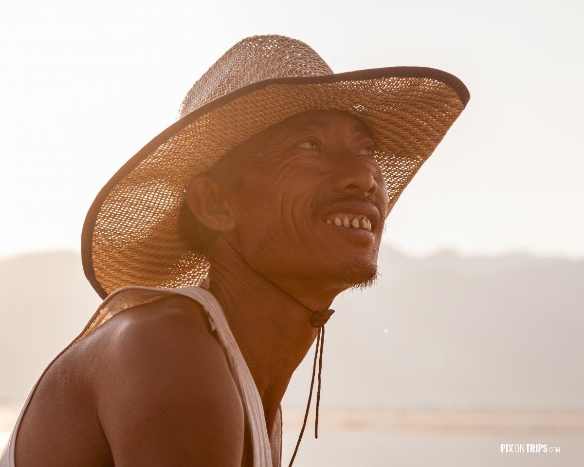 Portrait of fisherman at sunset, Lake Inle, Myanmar - Pix on Trips