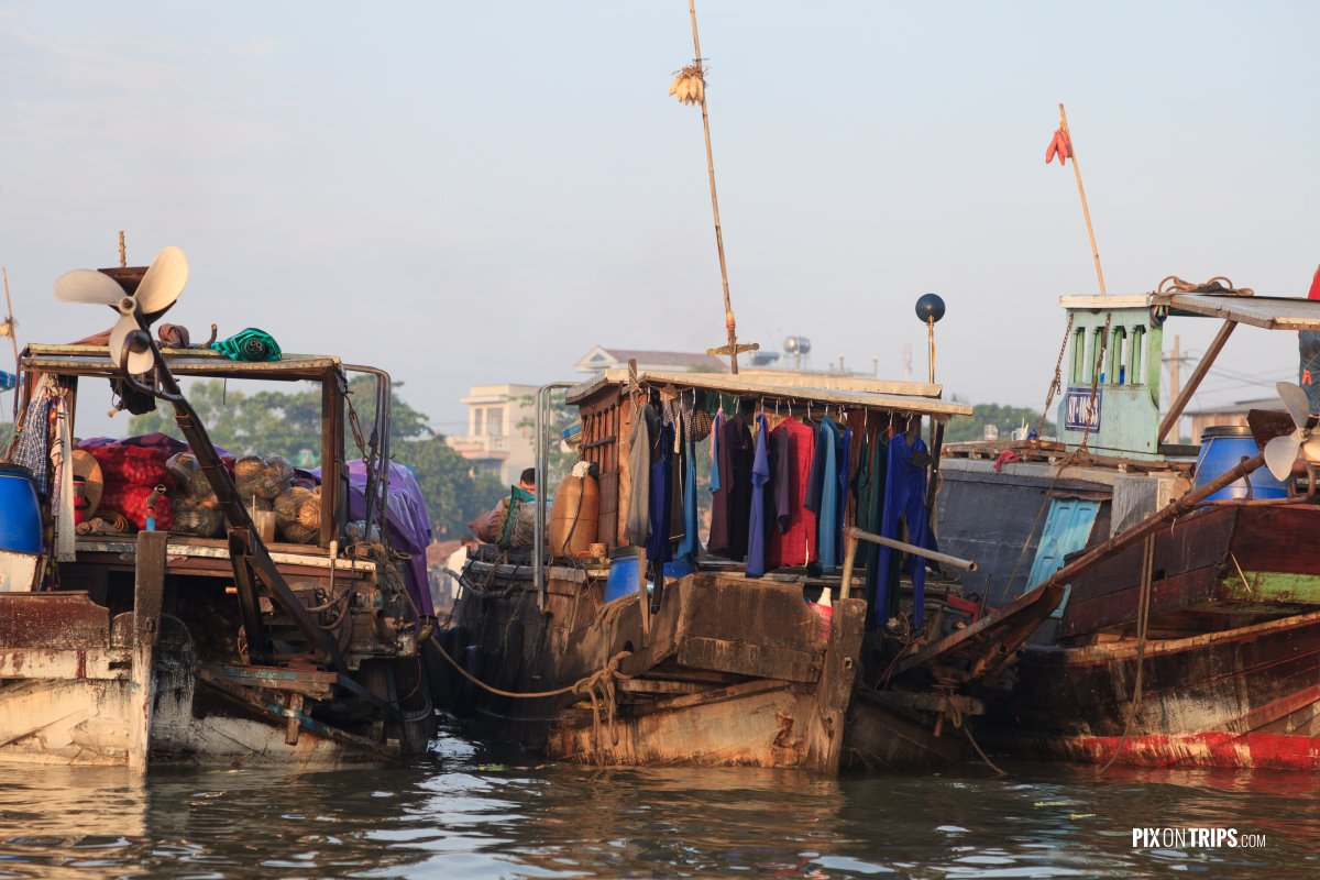 Rusty boats at Cai Rang floating market in early morning, Vietna - Pix on Trips