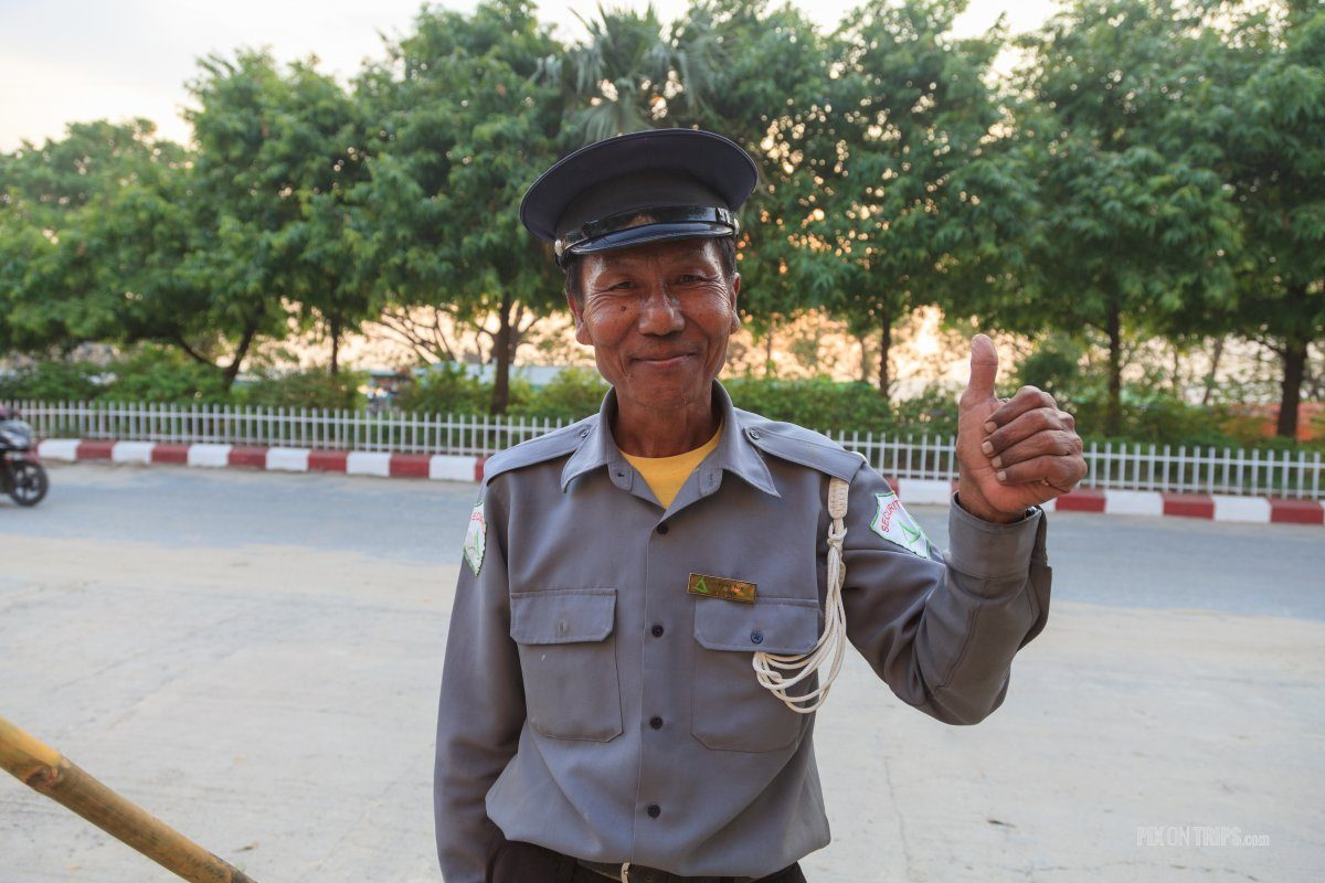 Security officer in front Ayarwaddy River View Hotel, Mandalay, Myanmar