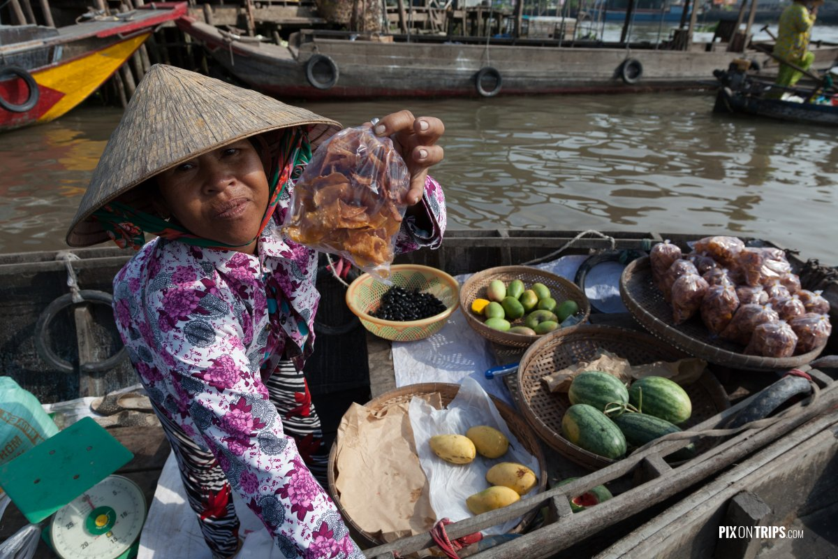 Vendor at Cai Be floating market, Vietnam - Pix on Trips