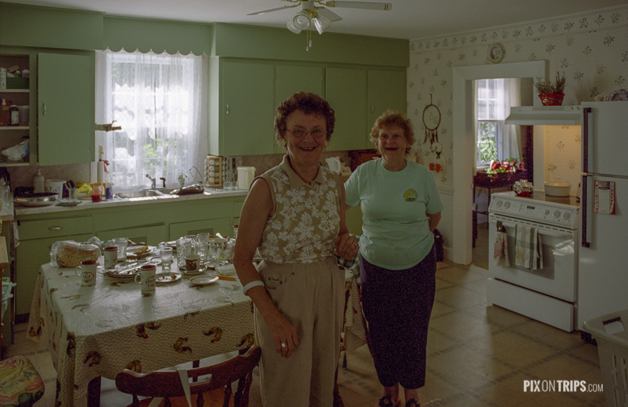 Two owners of the Red Door B&B stand in the kitchen, Mahone Bay, Nova Scotia