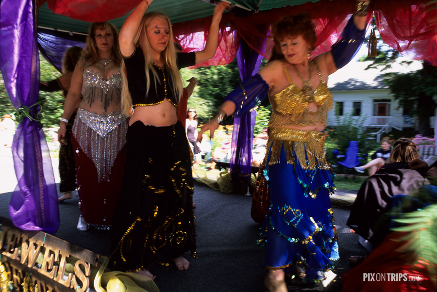 Women dance on float during Wooden Boat Festival, Mahone Bay, Nova Scotia, Canada