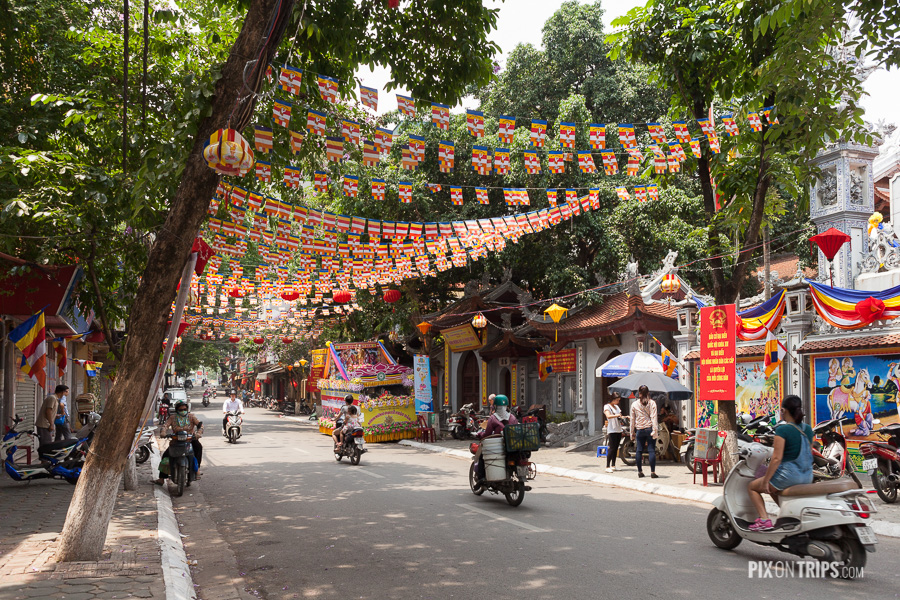 Street of Hanoi decorated with colourful lanterns and string banners