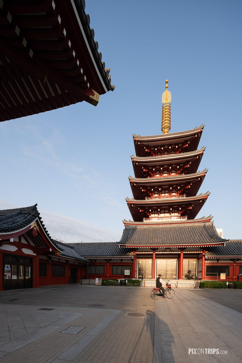 Man riding a bicycle passing by the Five-Story Pagoda at Sensoj - Pix on Trips