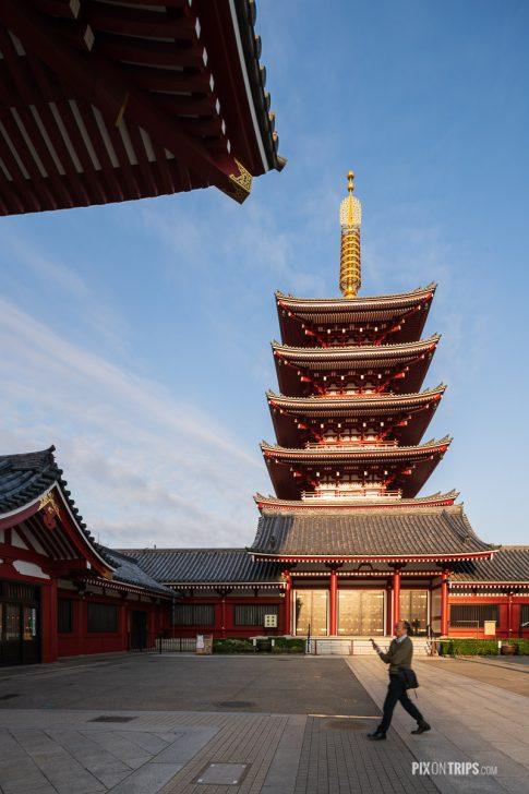 Man passes by the Five-Story Pagoda at Sensoji, Asakusa, Tokyo, Japan - Pix on Trips