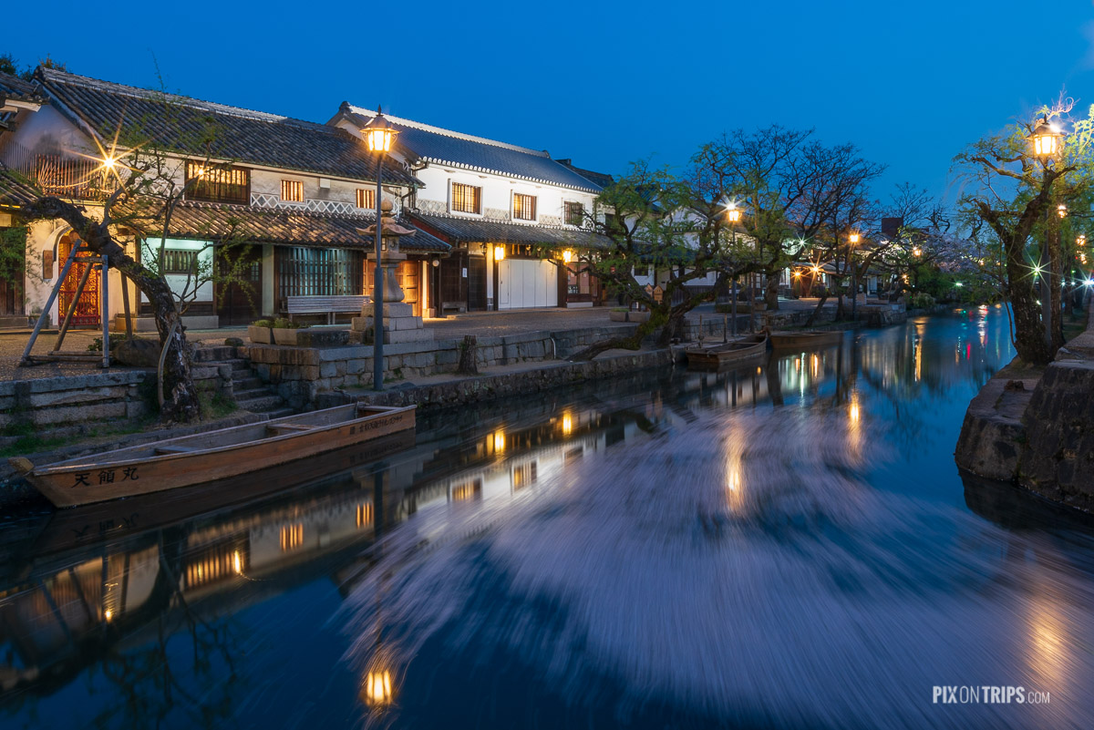 Flow of cherry blossom petals in the canal of the Bikan Historical Quarter at night, Kurashiki, Japan - Pix on Trips