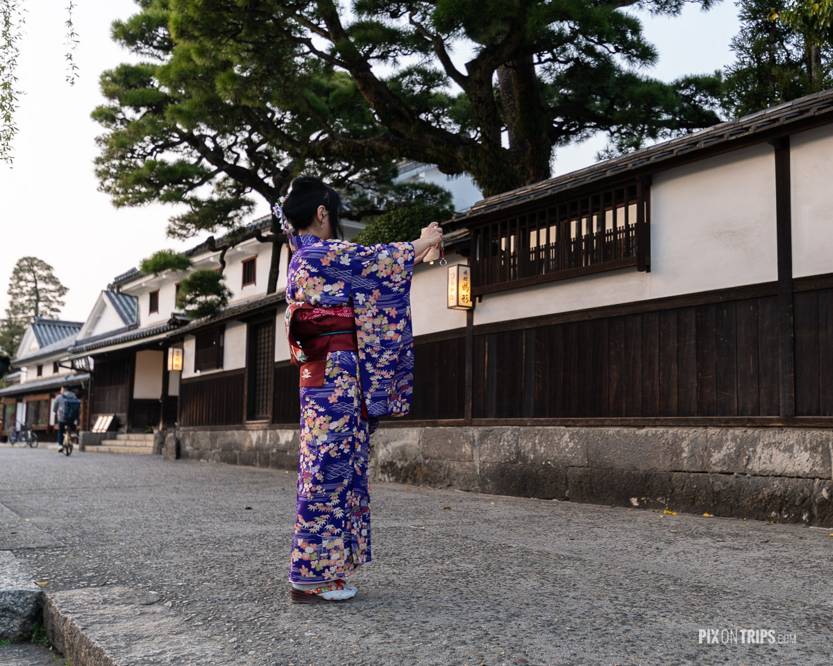 Woman in Kimono taking selfie at Bikan Historical district of Kurashiki, Japan - Pix on Trips