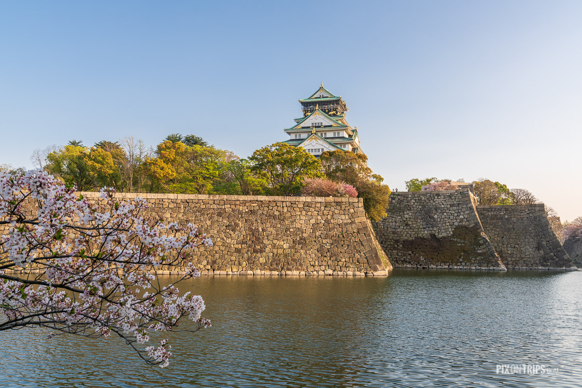 Osaka Castle and the outer moat during cherry blossom blooming season - Pix on Trips