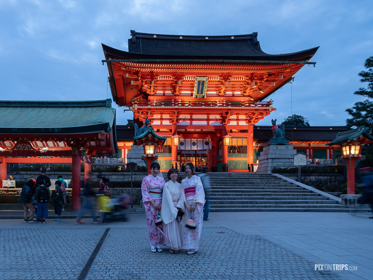 Women wearing Kimono posing for photo in front of Fushimi Inari-taisha, Kyoto, Japan - Pix on Trips