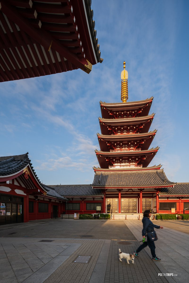 Woman passes by the Five-Story Pagoda at Sensoji, Asakusa, Tokyo - Pix on Trips